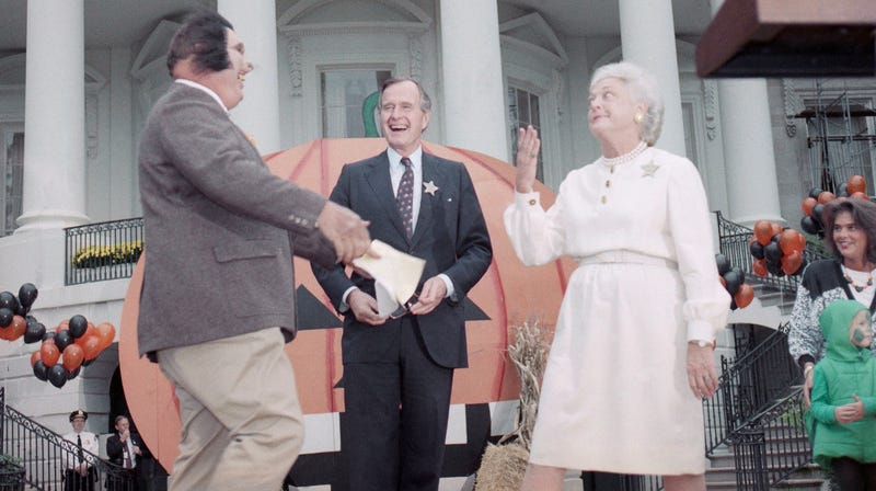 Television personality Willard Scott, left, dressed as a werewolf, clowns with President George H. W. Bush, center, and First Lady Barbara Bush at a Halloween party on the White House lawn, Tuesday, Oct. 31, 1989. Photo via AP Images.