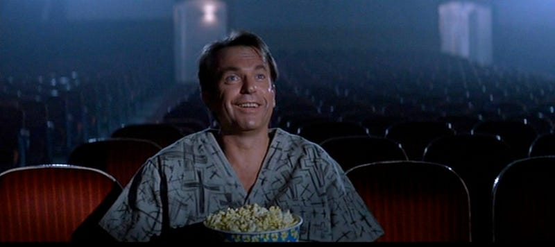 Sam Neill watches his own movie in John Carpenter's In the Mouth of Madness.