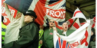 Skinheads participate in a neo-Nazi rally by the far-right National Front on April 7, 2001, in England. (Sion Touhig/Newsmakers)