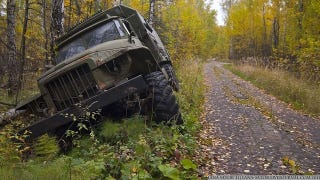 Illustration for article titled Excellent pictures of abandoned Russian military vehicles found in the woods