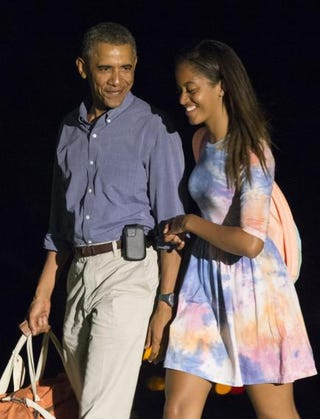 President Barack Obama and older daughter Malia return to the White House from Martha's Vineyard in Massachusetts Aug. 17, 2014.Kevin Dietsch-Pool/Getty Images