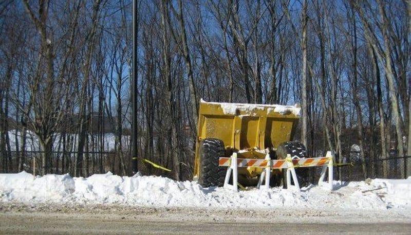Illustration for article titled Giant Dump Truck Tries Sledding, Fails Miserably
