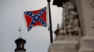 The Confederate flag flies on the Statehouse grounds in Columbia, S.C., June 23, 2015, one day after South Carolina Gov. Nikki Haley announced that she would call for the Confederate flag to be removed.Win McNamee/Getty Images