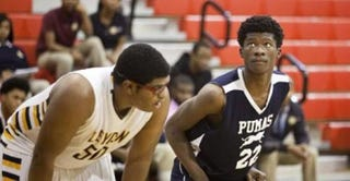 Demacio Bailey (right) during the basketball game Dec. 15, 2014, at Johnson College Prep in ChicagoChicago Sun-Times via Facebook