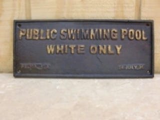 Illustration for article titled Landlord Defends 'Whites Only' Pool Sign