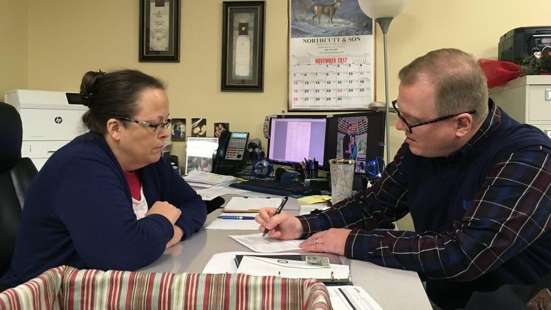 David Ermold, right, files to run for Rowan County Clerk in Kentucky as Clerk Kim Davis watches. (Image via AP)