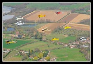 Illustration for article titled Volcanic Ash Grounds Commercial Flights In UK, But Tiger Moth Antiques Soar High