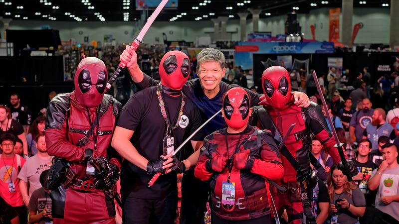 Rob Liefeld poses with Deadpool character cosplayers onstage Stan Lee's Los Angeles Comic Con 2017.
