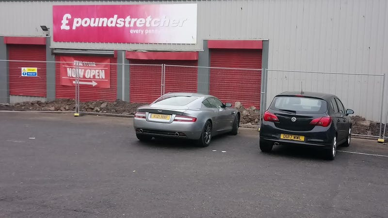 Illustration for article titled Aston Martin DB9 spotted at Pound Stretchers