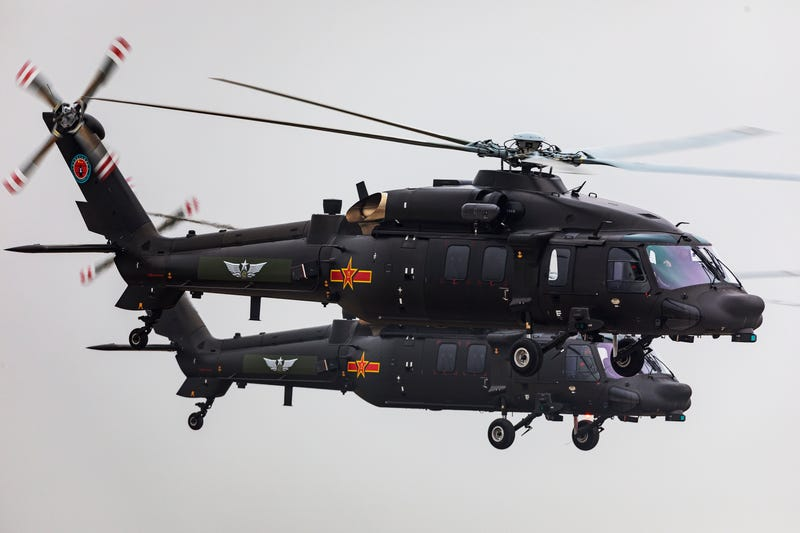 Z-20 helicopters fly during The 5th China Helicopter Exposition at Free Trade Zone of Tianjin Port on October 10, 2019 in Tianjin, China.