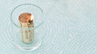 Illustration for article titled Soak Corks in Alcohol to Make Cheap Candles