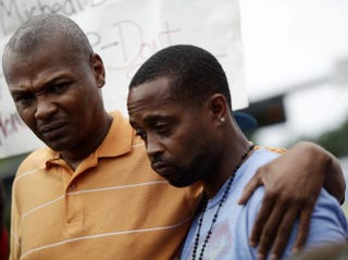 Michael Brown's cousin Eric Davis and Louis Head, Brown's stepfather, attend a news conference Aug. 15, 2014, in Ferguson, Mo.Joshua Lott/AFP/Getty Images