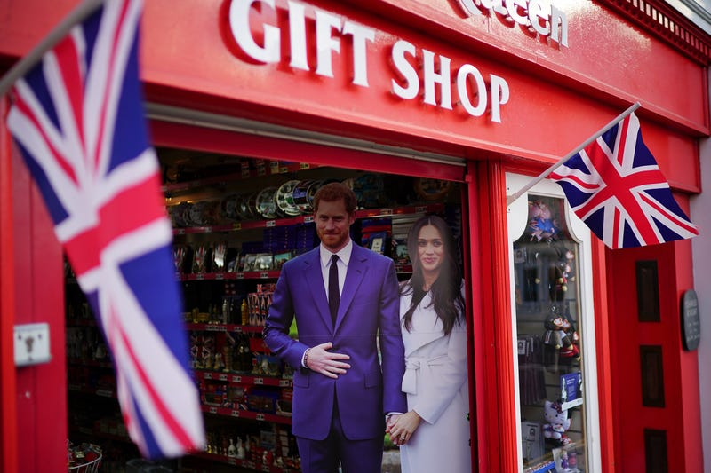 Life-size photographs of Prince Harry and his fiancee, Meghan Markle, are displayed in a gift shop on May 2, 2018, in Windsor, England.