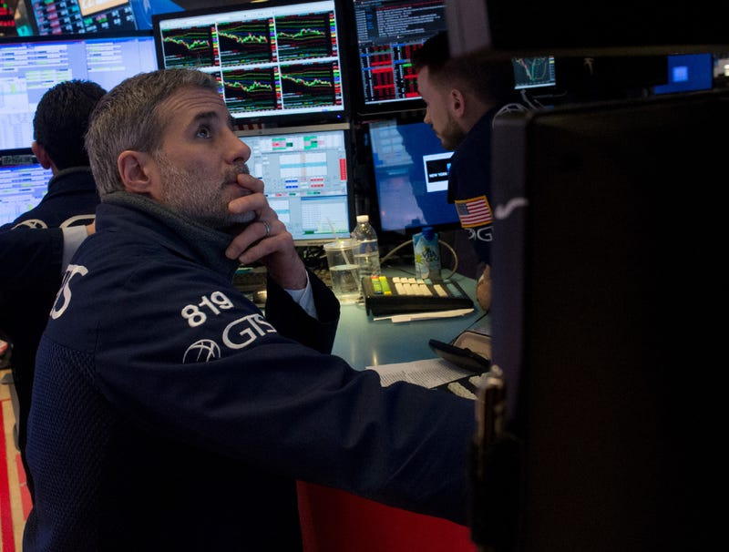 Illustration for article titled Dow Drops 600 Points Over Picture Of Worried Stock Broker Staring At Computer Screen