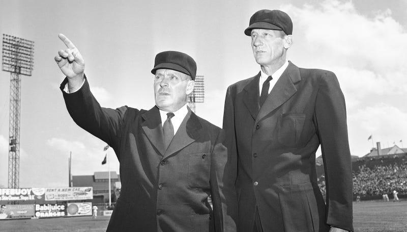 Umpires Lon Warneke and Bill Stewart in 1949. Image via AP.