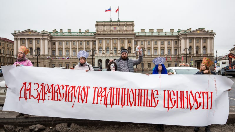 Russian activists, headed by theatre director Leda Garina, demonstrate a placard saying 'Long live the traditional values', as they perform during a protest action against a bill decriminalizing domestic violence on January 29, 2017 in Saint Petersburg, Russia. Image via Getty.
