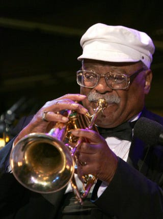 Jazz great Clark Terry performs at the celebration of the 20th anniversary of the Thelonious Monk Institute of Jazz in the East Room of the White House Sept. 14, 2006, in Washington, D.C. Dennis Brack-Pool/Getty Images
