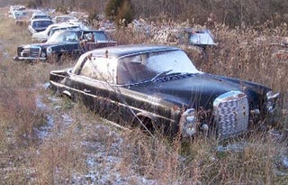 Over Vintage Mercedes Benzes Await The Cruel Jaws Of The