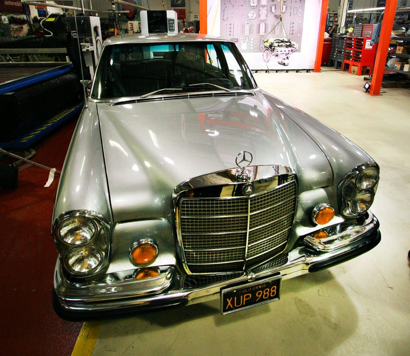 Jay leno building stonkin 39 amg powered german hell sled for Garage mercedes 94
