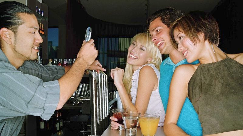 Illustration for article titled Of Course Busy Bartender Doesn't Mind Taking Picture Of You And Your Friends