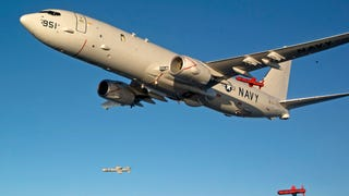 This Shot Of A P-8 Poseidon Dropping Three Harpoon Missiles Is Triumphant
