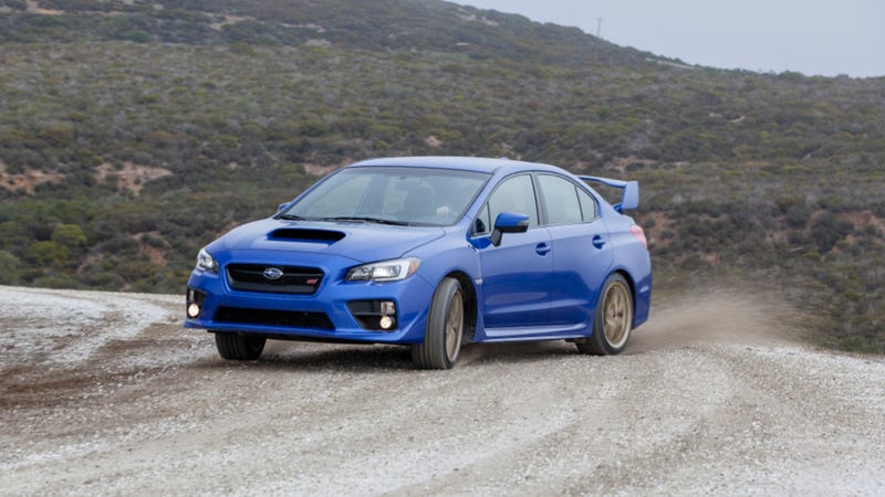 Illustration for article titled 2015 Subaru WRX STI: The Big Winged Rude Blue Rally Machine You Deserve