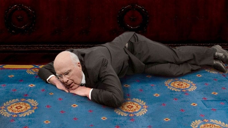 Illustration for article titled Loyal Senator Still Lying Patiently In Spot Where Beloved Bill Died