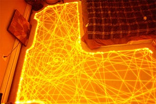 Illustration for article titled Long-Exposure Shot of a Roomba's Path Shows Beautifully Organized Chaos