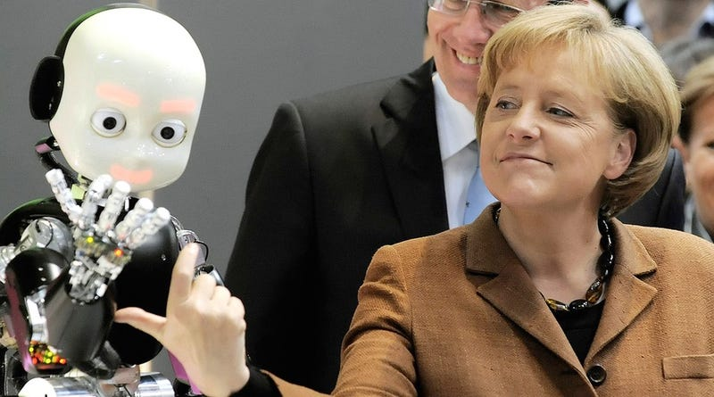 Illustration for article titled Why Is Angela Merkel Always Palling Around With Robots?