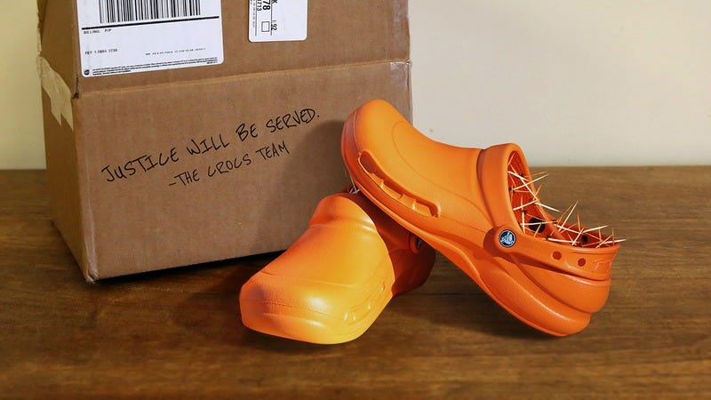 An orange pair of barbed Crocs.