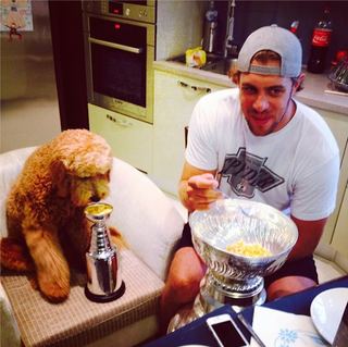 Illustration for article titled Anze Kopitar And His Dog Enjoy Stanley Cup Breakfasts