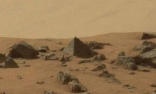 Illustration for article titled Did Curiosity Rover discover a pyramid on Mars?
