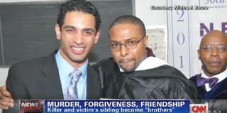 Anthony Colon and Michael Rowe at Rowe's graduation ceremony in 2012 (CNN)