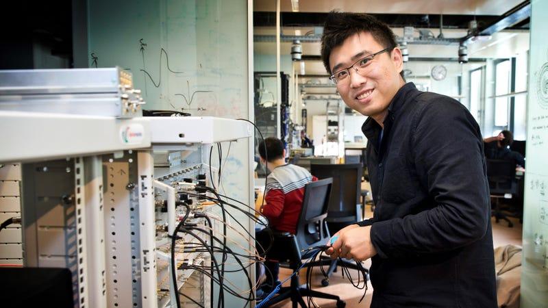 Researcher Hao Zhang making measurements