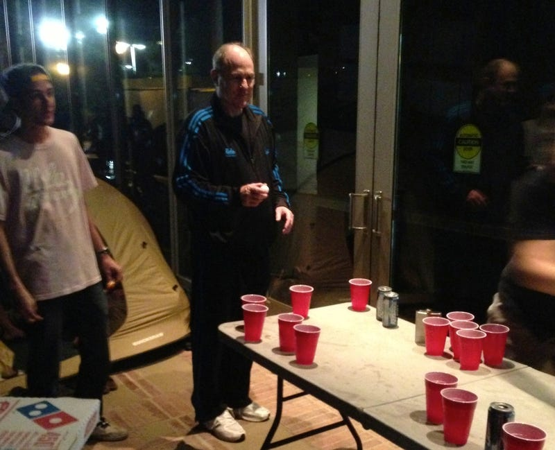 Illustration for article titled Here's A Photo Of UCLA Head Coach Ben Howland, In A Tracksuit, Playing Beer Pong With Students Last Night
