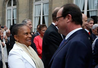 French President François Hollande greets French Justice Minister Christiane Taubira during a reception in honor of the French armed forces at the Hôtel de Brienne in Paris July 13, 2014.THOMAS SAMSON/AFP/Getty Images