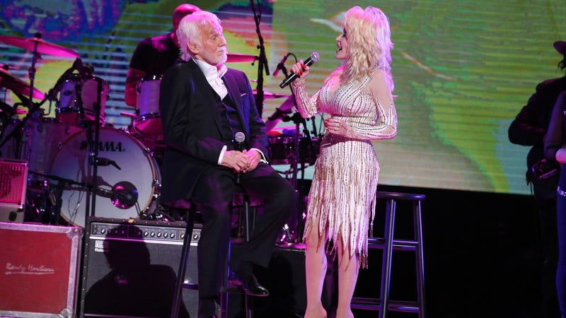 """Dolly Parton singing """"I Will Always Love You"""" at Kenny Rogers's farewell concert on October 25th. Image via the AP."""
