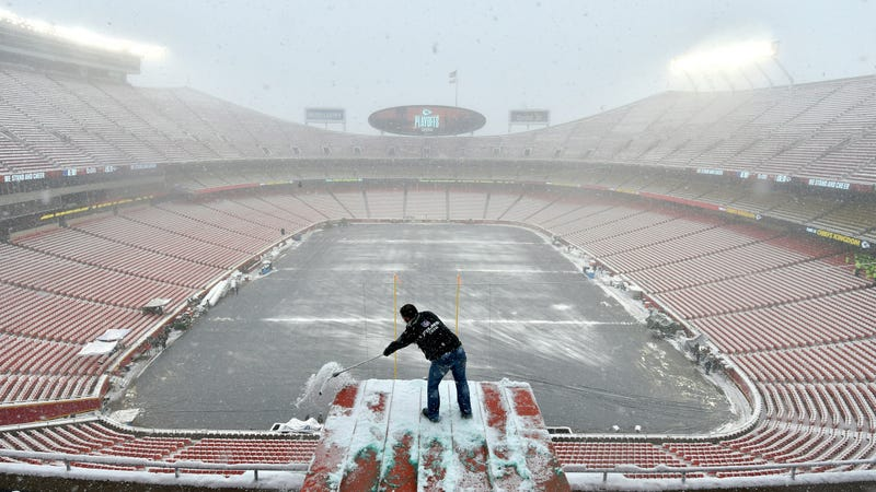 Clearing snow ahead of the Kansas Chiefs playoff game last weekend. The coming weekend's game promises to be even colder.