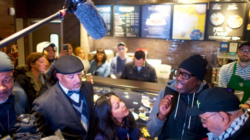 Protestor Asa Khalif (R) addresses Starbucks Mid-Atlantic Regional Vice President Camille Hymes (C) on Monday in the Philadelphia Starbucks where police arrested two black men, prompting an apology from the company's CEO.