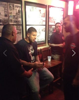 Illustration for article titled Here's A Photo Of Aaron Hernandez Getting Kicked Out Of A Bar