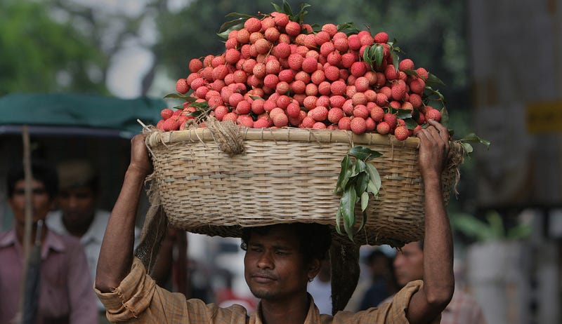 A vendor with lychees in India (Image: AP)