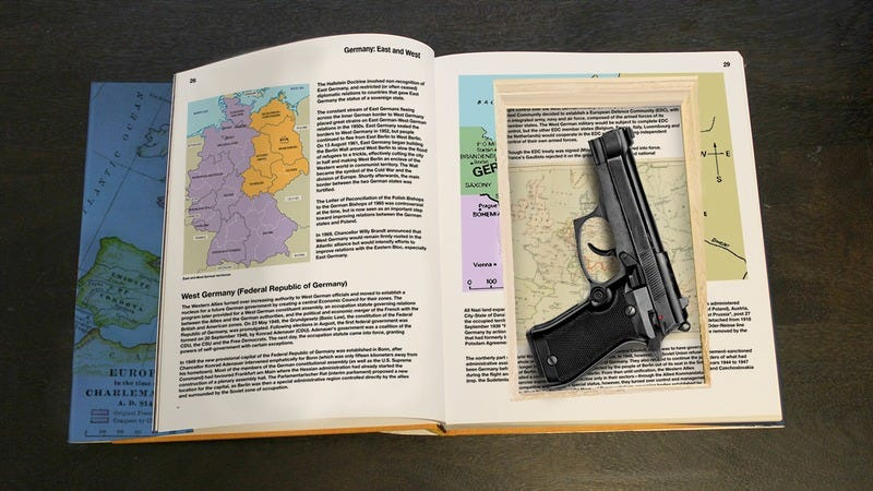 A gun inside of a hollowed-out textbook.