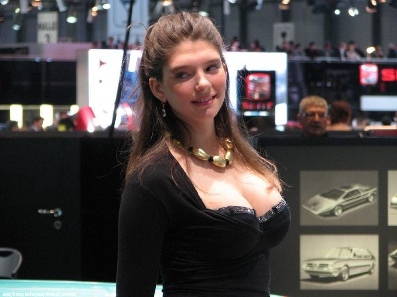 Illustration for article titled Now It's Time To Play Guess The Age Of The Geneva Booth Babe!