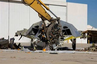 Illustration for article titled F-117 Stealth Fighter + Caterpillar Crusher = Pile of Sadness