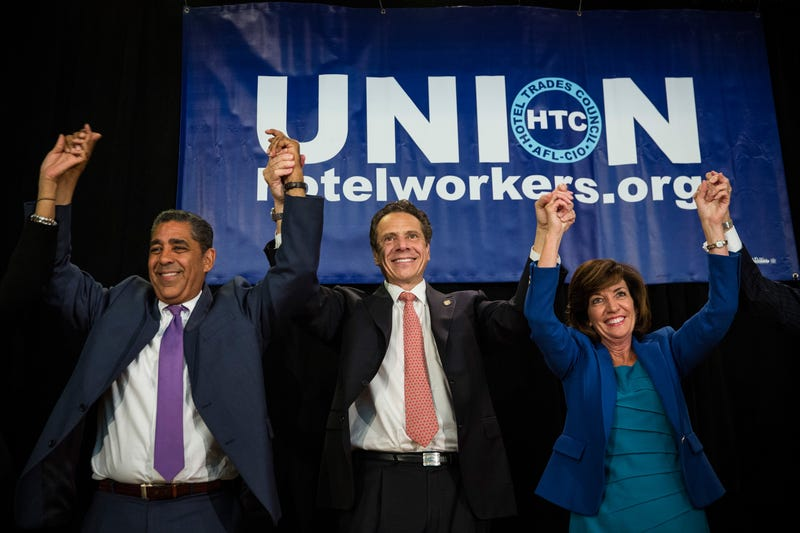 Rep. Adriano Espaillat, New York Gov. Andrew Cuomo and New York Lt. Gov. Kathy Hochul (Andrew Burton/Getty Images)