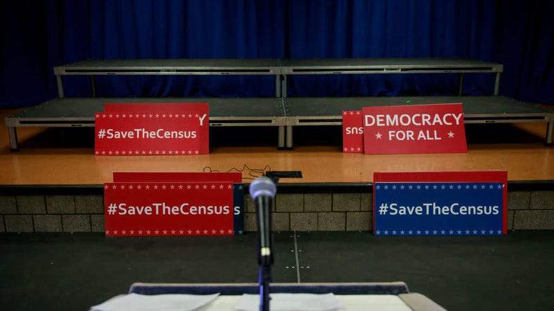 Signs sit behind the podium before the start of a press conference with New York's then attorney general to announce a multistate lawsuit to block the Trump administration from adding a question about citizenship to the 2020 census form, April 3, 2018, in New York City.