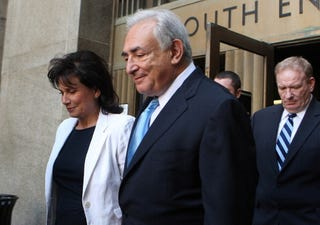 Strauss-Kahn and his wife leaving court (Getty Images)