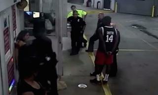 Officer Akinyemi Borisade grabs onto Mayra Martinez (against the wall) before punching her.CNN screenshot
