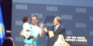 Elaih Wagan's father holds her at the NRA convention. (Twitter)