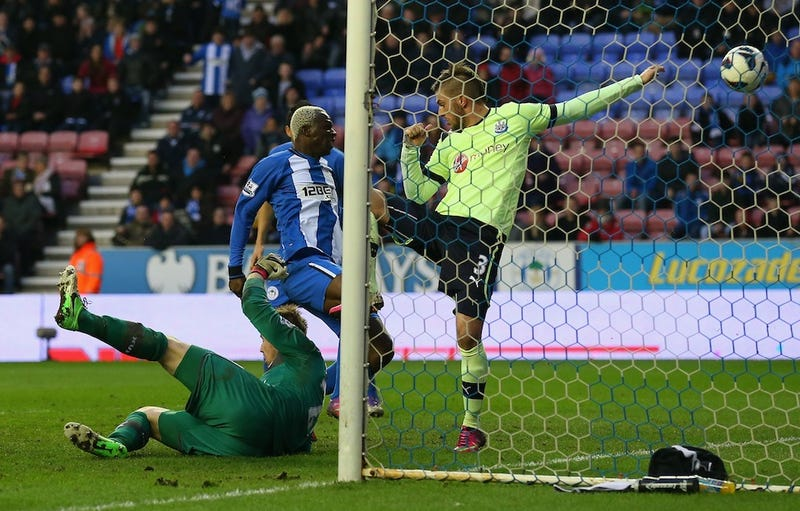 Illustration for article titled Last-Minute Handball Sends Wigan Athletic Past Newcastle